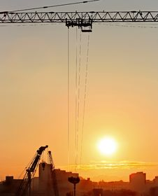Free Sunrise In The City With Cranes Silhouettes Stock Photos - 8850643