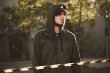 Free Man In Black Zipped Hoodie And Black Ny Embroidered Cap Standing During Daytime Royalty Free Stock Photo - 88562795
