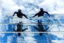Free Gendarmes Climbing Down Building Royalty Free Stock Images - 88563909