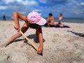 Free Girl Shoveling Sand Stock Photos - 8860153