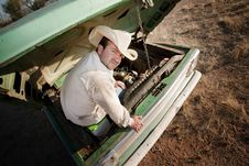 Free Man Under The Hood Of His Truck Stock Photo - 8860020