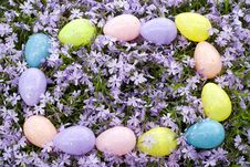 Colored Easter Eggs On A Floral Background Stock Photos