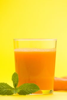 Fresh Carrot Juice And Mint Stock Photography