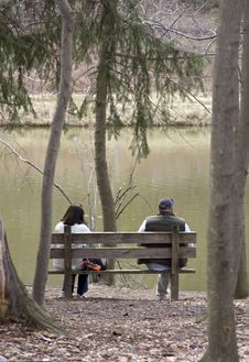 Free Couple Sitting On Wooden Bench Stock Images - 8861464