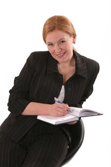 Free Smiling Woman With Notebook Royalty Free Stock Photos - 8865038
