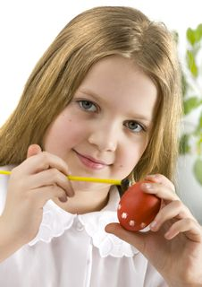 Happy Little Girl Painting Easter Eggs Stock Image