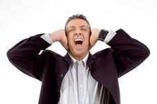 Shouting Businessman Putting Hands On His Ears Royalty Free Stock Photography