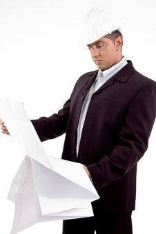 Free Side View Of Architect Looking The Blueprint Royalty Free Stock Images - 8871639