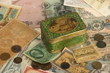 Background With Old Currency And Box Royalty Free Stock Images
