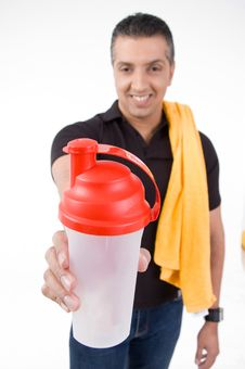 Free Front View Of Smiling Man Offering Water Bottle Stock Photos - 8872213