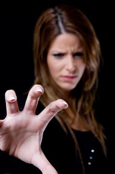 Portrait Of Beautiful Female Showing Hand Gesture Stock Photo