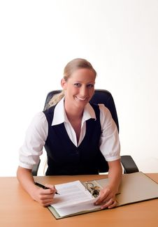 Free Young Woman Is Working With A Folder At The Desk Stock Image - 8872911