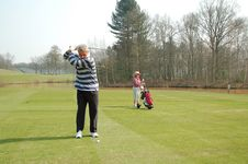 Male Golfer Teeing Off Stock Images