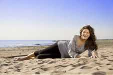 Beautiful Brunette Girl On The Beach Royalty Free Stock Image