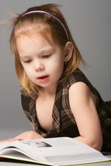 Girl Lying And Reading Book. Stock Photos