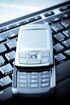 Phone And Keyboard Stock Images