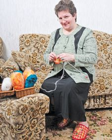 Woman With Sewing Royalty Free Stock Images