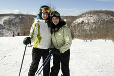 Two Sisters Happy To Be On Ski Slopes Royalty Free Stock Photography
