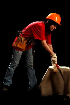Young Woman With Work Tools And Hand Saw Royalty Free Stock Photo