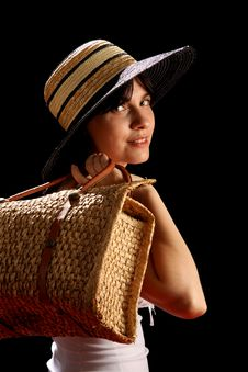 Young Woman With Straw Hat And Bag Royalty Free Stock Image