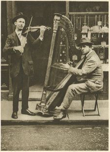Free The Strains Of The Itinerant Harpist Come Through The Din Of Traffic Stock Images - 88752034