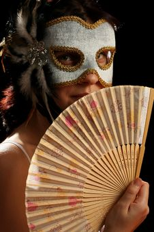 Free Young Brunette With Venetian Mask And Spanish Fan Stock Images - 8880094