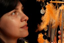 Young Brunette And Wind Chime Stock Image
