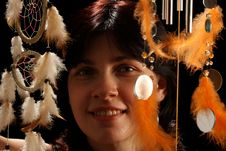 Young Brunette With Wind Chime And Dream Catcher Royalty Free Stock Photos