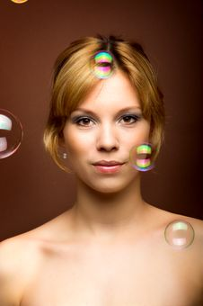 Young Woman With Soap Bubbles Stock Photo