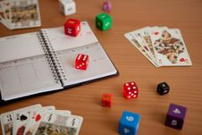 Agenda With Dices And Tarots Royalty Free Stock Image
