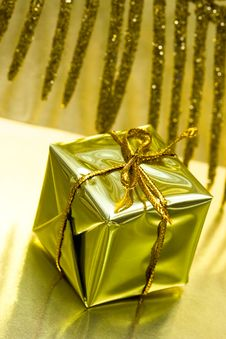 Free Gift Box On Golden Background Royalty Free Stock Photo - 8888335