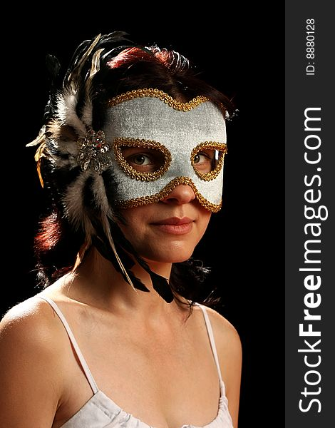 Young brunette with venetian mask