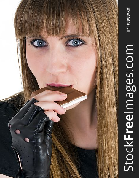 Girl taste chocolate