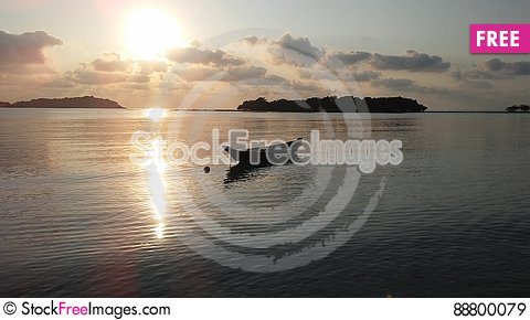 Free Boat In Front Of Ko Na Thian And Ko Mat Lang Islands During Sunrise On Koh Samui Island, Thailand. Royalty Free Stock Images - 88800079