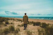 Free Man Walking Along Beach Stock Photo - 88892430