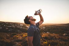 Free Man Pouring Water Bottle On His Mouth Stock Images - 88892654