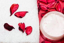 Free Cream And Towel With Red Petals Stock Image - 8890991