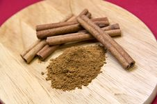 Free Cinnamon Sticks On Red- Tight Depth Of Field Royalty Free Stock Images - 8892099