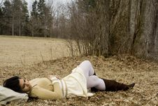 Free Indian Girl Lying Down In Fall Stock Images - 8892754