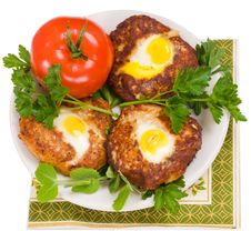 Free Cutlets And A Tomato. Royalty Free Stock Photos - 8892978