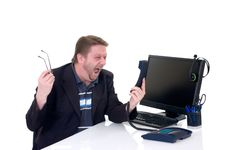 Angry Businessman On Desk Stock Photo