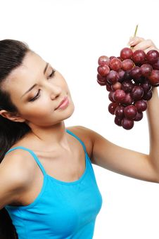 Free Woman Holding A Bunch Of Grapes Stock Image - 8895821