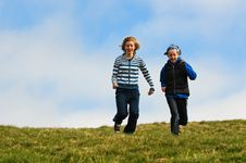 Free Girls Running Down A Hill Royalty Free Stock Image - 8896806