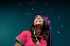 Free Soap Bubble Blowing Downwards On The Head Of Girl Stock Photography - 8897182