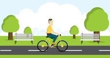 Active Young Man Riding On Bicycle. Stock Image
