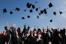 Free Graduates Throwing Mortarboards Stock Photo - 88986270