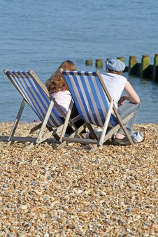 Free Deckchairs On The Beach Stock Image - 893041