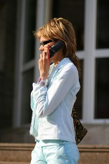 Free Young Woman Walking On The Street And Talking On The Phone Stock Image - 893641