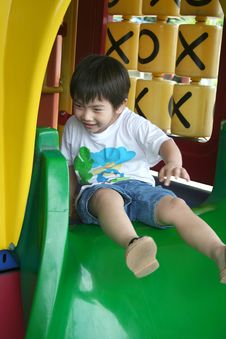 Free Boy On The Slide Royalty Free Stock Image - 894436