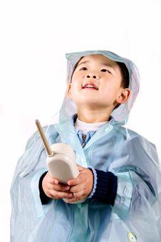 Free Boy Telephoning In Raincoat Royalty Free Stock Image - 8904866